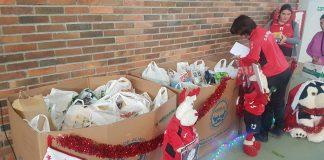 El CB Nigrán encesta más alimentos que nunca en la V edición de su Torneo Solidario de Navidad